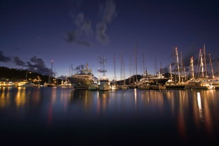 Sunset light over anchored boats on tropical island photo