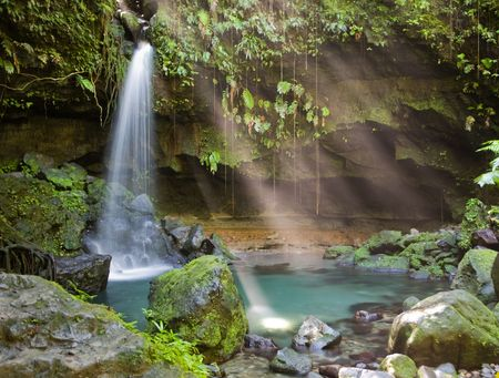 Spectacular waterfall and pool on lush tropical island photo