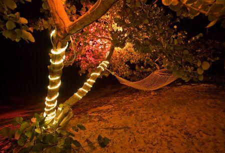 Beachside hammock at night Reklamní fotografie