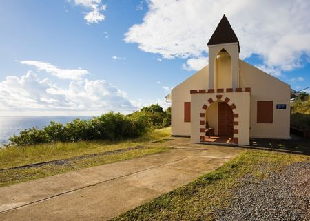 Whitewashed church on tropical island Stock Photo