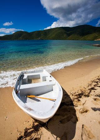 Small boat on the shore of a tropical island Stock Photo - 2774505