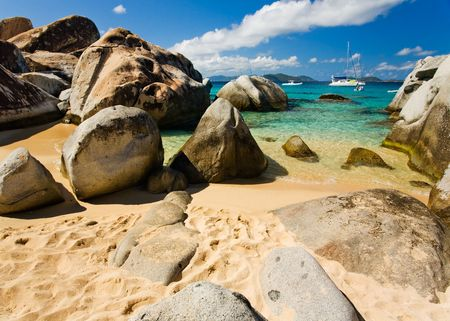 remoteness: Massive boulders and crystal-clear waters on tropical island Stock Photo
