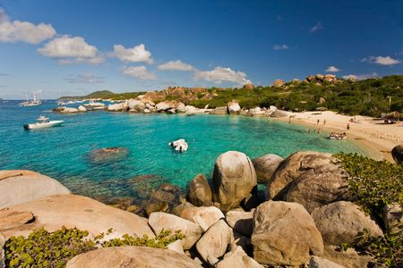 Massive boulders and crystal-clear waters on tropical island photo