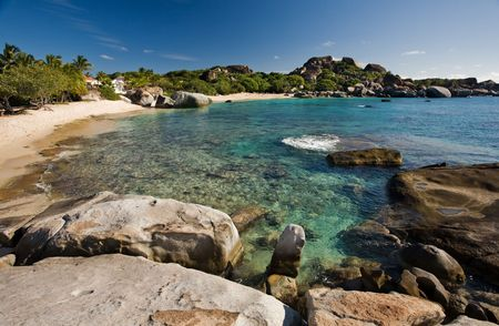 Massive boulders and crystal-clear waters on tropical island Stock Photo - 2774561