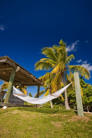 Hammock and shelter on tropical island Stock Photo