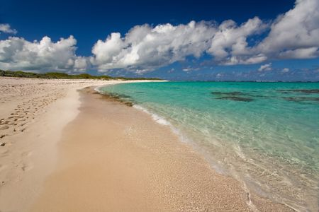 pristine corals: Tropical white sand beach and turquoise waters Stock Photo