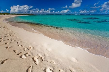remoteness: Tropical white sand beach and turquoise waters Stock Photo