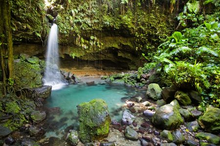 Spectacular waterfall and pool on lush tropical island Stock Photo - 2774642