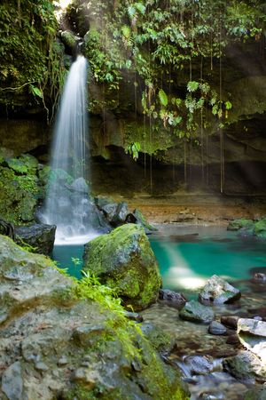 Spectacular waterfall and pool on lush tropical island Stock Photo - 2774617