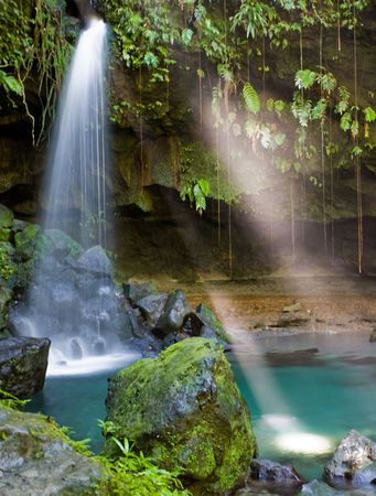 remoteness: Spectacular waterfall and pool on lush tropical island Stock Photo