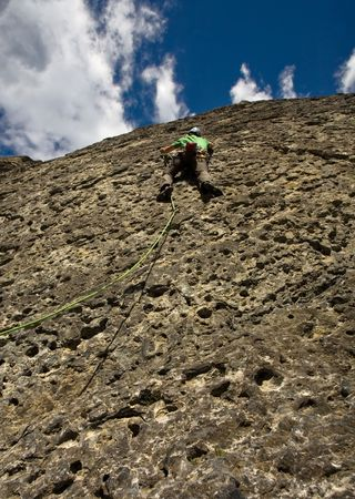dropoff: Young man rock-climbing in the Canadian Rockies