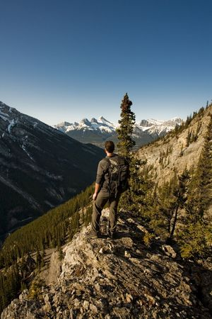 Young man exploring the Canadian Rocky Mountains in the Spring Stock Photo