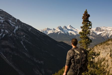 Young man exploring the Canadian Rocky Mountains in the Spring Stock Photo - 3088445