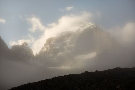 Peak shrouded in mist in the Rocky Mountains, Banff National Park, Alberta, Canada. Stock Photo