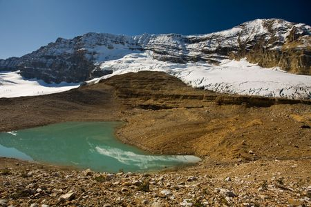 Glacier-fed lake at the base of snowy peaks in the Rocky Mountains, Iceline, Yoho National Park, British Columbia, Canada.
