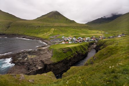 Small oceanside village surrounded by green hills, Gj—gv, Faroe Islands, Scandinavia