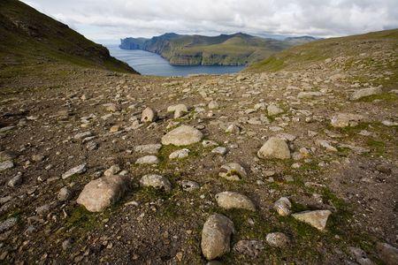 Rocky landscape with ocean in the background, Faroe Islands, Scandinavia