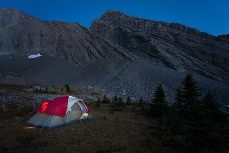 Starry night of camping in the Rocky Mountains, Kananaskis Country, Alberta, Canada.