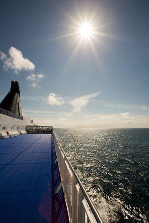 Sun shining in blue sky from deck of cruise ship, Norway, Scandinavia