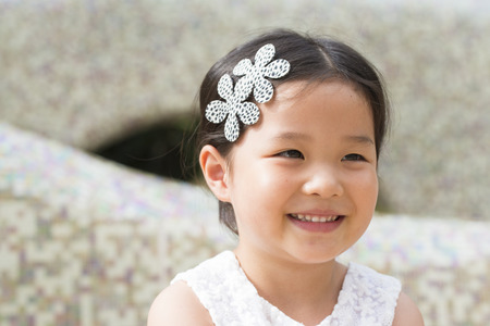 Close up view of little asian girl photo
