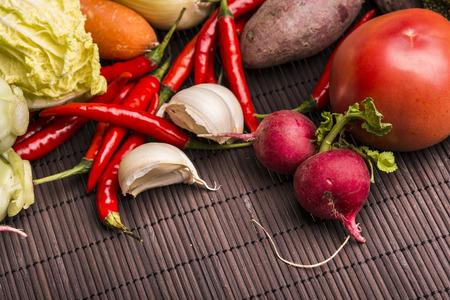 bamboo mat: Chillies,garlic,tomato,cabbage,radish on bamboo mat Stock Photo