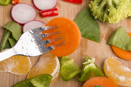Different fruits and vegetables on wooden table photo