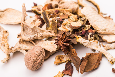 badian: Different spices,anise,cinnamon isolated on white.