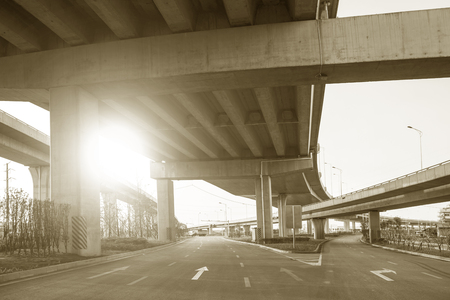 curve road: View under a fly over Stock Photo