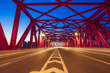 Landscape view of structural bridge during night time Stock Photo