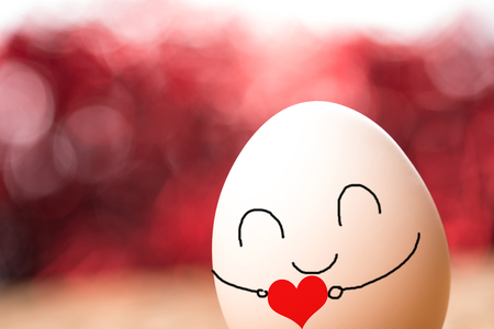 Close up view of an egg hugging a heart shape Stock Photo