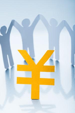 Renminbi paper cutting symbol and paper man
