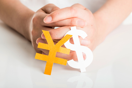 Human hand and currency symbol Stock Photo