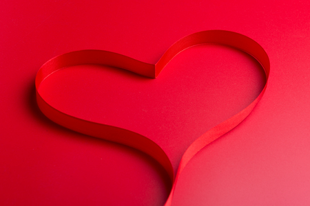 Red ribbon on red background Stock Photo