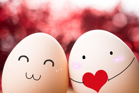 Expressive eggs on red background Stock Photo