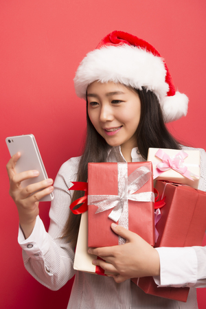 Asian female white-collar holding a gift Stock Photo