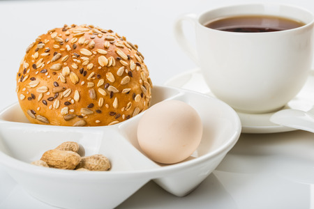 energy needs: Western style breakfast with bread, eggs and a cup of tea Stock Photo