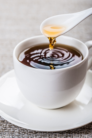 energy needs: Black tea in a cup on the table Stock Photo
