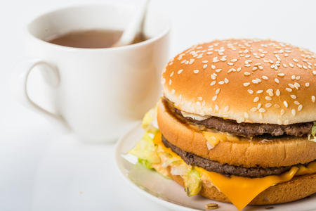 non: Western style breakfast with a burger and a cup of tea Stock Photo