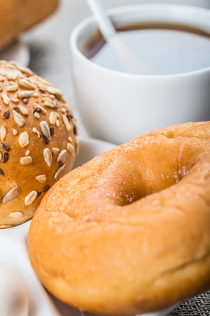 energy needs: Western style breakfast with bread, donut and a cup of tea