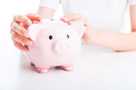 20 years old: Hands holding a piggy bank on white background Stock Photo