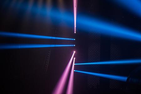 The concert stage lights dazzling spotlight