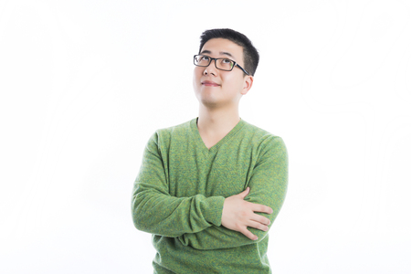 A young man in a green sweater