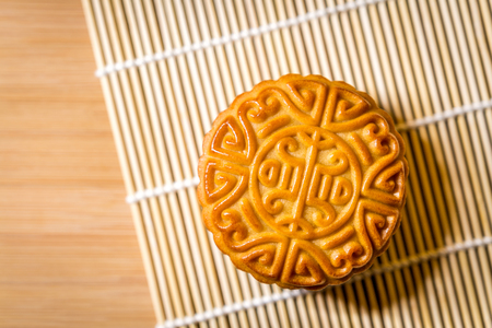 A moon cake placed on a board