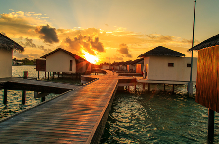 The charming scenery at sunset in Maldives