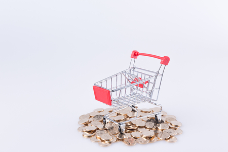 Shopping cart and gold coin in the white background
