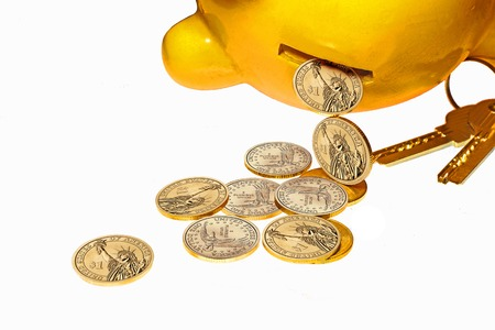 Money box and coin key Stock Photo