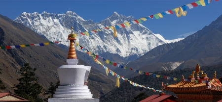 Tengboche Monastery, is located in the in the Khumbu region of eastern Nepal and is a working Tibetan Buddhist monastery In the background the peaks of Lhotse  right hand side  The worlds 4th largest mountain and adjacent peak Nuptse rise sharply from the photo