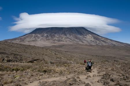 A group of porters passing through The saddle area on Rongai Route, Kilimanjaro Stok Fotoğraf