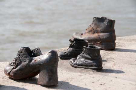 persecution: The Shoes on the River Danube Promenade Stock Photo