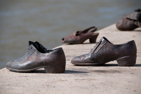 persecution: The Shoes on the bank of the Danube River in Budapest Stock Photo